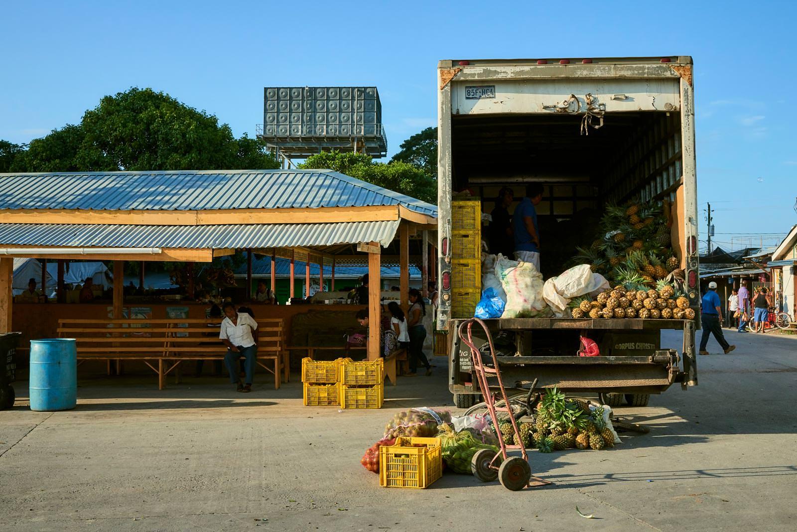 Vendors unloading at the local market in Orange Walk Town.